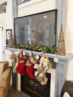 how to do a christmas mantle that has a tv keep the garland simple and low profile christmasmantle stockings - Christmas Tv Decoration