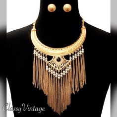 Stunning Aztec inspired collar Gold tone chocked with attached chain and lobster claw clasp. Chains , faux pearls and arrow shaped pendant with a black centerpiece and adorned by rhinestones. Matching button earrings( pierced). PARA Ti Jewelry Necklaces