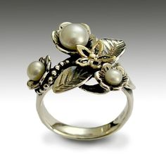 Sterling silver and yellow gold floral ring with pearls