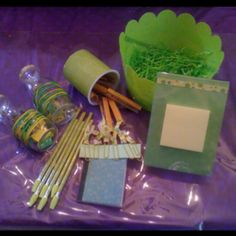 """My Pinteresting spring.....crafting teachers' end-of year gifts.   Started by finding out their favorite colors, then gathering all the supplies.  Basket with paper shred/grass to hold everything.  Mod-Podged scrapbook paper onto a plastic """"can"""" (from the frosting used to make their Valentine's fudge). Also Mod-Podged pencils and clothespins (superglued a magnet strip to the back). Glued paper to re-cover small composition notebooks. Tied ribbon to large, colorful ribbon for bookmarks. Glued…"""