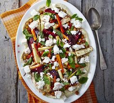 Combine roasted vegetables with chickpeas and feta cheese in this Greek-inspired salad which provides an impressive 4 of your 5 a day