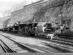 Understell og kjel til Hovedbanens damplok litra A på traller under transport på Havnebanen @ DigitaltMuseum.no