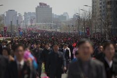 North Koreans walk down a street after a military parade in Pyongyang's Kim Il Sung Square celebrating the anniversary of the birth of the late North Korean founder Kim Il Sung on April (David Guttenfelder / AP) Life In North Korea, Spiritual Armor, Stalinist, Think Deeply, Armor Of God, Korean War, Presidents, Dolores Park, Singing