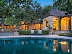 4906 Park Lane, Dallas TX 75220 is For Sale - Zillow | Old Preston Hollow neighborhood | 5 heavily wooded park-like acres along Bachman Creek | 10,005 sf | 4 bed 7 bath | originally built 1939 | 13,000,000 USD | native trees, creek with stone bridge, wisteria-covered pergola walkway, pool, outdoor dining pavilion, tennis court, and two putting greens | master suite with his/her baths/closets | considered one of the classic Park Lane estates in Preston Hollow