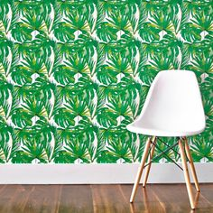 Brighten up your walls with this green leaf print wallpaper.