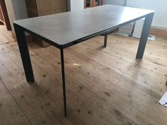 Link ceramic extendable dining table Robust ceramic top material with steel frame in stone matt lacquer. Delivered to our client in Surrey.