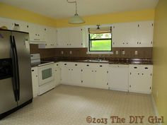 Diy Kitchen Cabinets Before And After use beadboard wallpaper and molding to dress up plain doors on