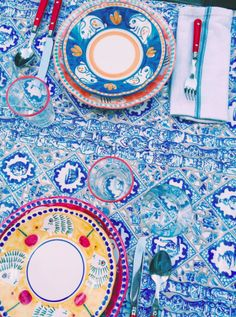 Blue and white tablescape with pops of pink