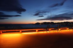 Let's sit down and enjoy... View of the Massif de l'Esterel and the Vieux Port at dusk seen from La Croisette in Cannes