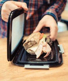 Lighten the load of your morning commute with this flat, flexible lunchbox that's your food's second skin as it fits around sandwiches, wraps and more without smashing them. Lunch Snacks, Lunch Box, Lunches, Dessert Dishes, Cool Inventions, Stuff And Thangs, Household Items, Japanese Food, Kitchen Gadgets