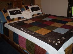 """Quilt of my own design using 10"""" charm squares, ribbon embroidery and hand quilting."""