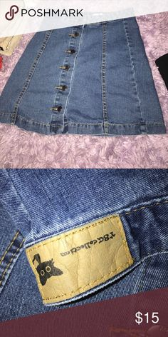 YBC Button Up Denim Skirt Super adorable and trendy. Makes your butt pop but has study buttons so it won't open up on you. Fit me well and I have pretty big hips. For someone with a small waist.  YBC Skirts Mini