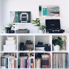 white ikea shelf unit | books, cameras, records, and plants | julia.cam