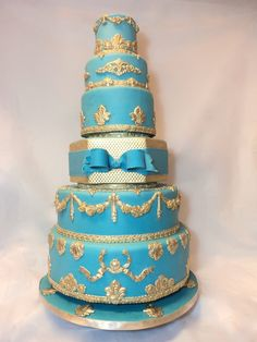 Gold and turquoise baroque wedding cake