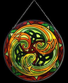 TRISKELE Stained Glass Celtic Art by Welsh artist Jen Delyth - Official Home Site - Celtic Tree of Life and Celtic Art Studio Catalog. Author of Celtic Mandala Calendar and Keltic Designs Textiles. Original Celtic art, symbols and meanings.