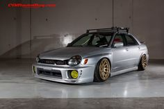 Stanced Subaru Impreza. I love everything about this car. Including the bike rack, which is what I want for my car!
