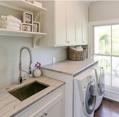 open shelves above sink and closed above washer and dryer for soap and supplies