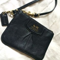 Coach Wristlet Selling this coach wristlet. Black leather with purple satin interior. It's in perfect condition, it's been sitting in my closet for years Coach Bags Clutches & Wristlets