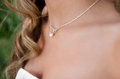 A delicate pearl necklace for the bride on her big day. {Photo by Pixy Prints Photography}