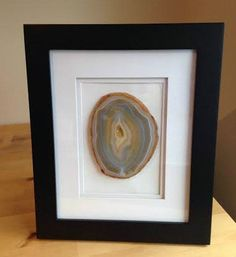 framed agate slice - maybe try frame with clear back & hang in window