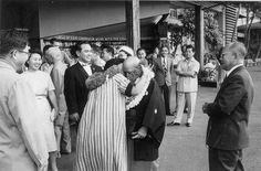 Aikido Founder Morihei Ueshiba arrives at the Honolulu International Airport in 1961 and gets a local Hawaiian greeting.