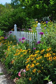 Picket fence and flowers just go together...
