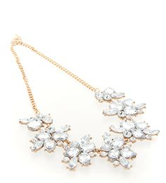 Dazzle your outfit with this gold-plated necklace inspired by raw diamond rocks.