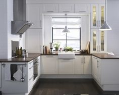 Top Hardware Styles To Pair With Your Shaker Cabinets | If you're looking for a more contemporary approach, tubular bars seem to be a favorite of the future.