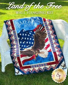 Land Of The Free Wall Hanging Kit: From Sandy Boobar and Sue Harvey of Pine Tree Country Quilts comes the Land Of The Free Wall Hanging! This beautiful quilt features a beautifully illustrated patriotic panel surrounded by a gorgeous pieced border, creating the perfect addition to your home. Finishes to approximately 36