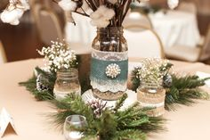 Baby's breath and pine cones accent this centerpiece (http://www.7centerpieces.com/victoria-wedding-simply-love-photography/) | Simply Love Wedding Photography (http://simplylovephotography.com/)