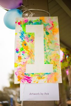 Personalize Baby's First Birthday Party by displaying a finger painting masterpiece created by the birthday child