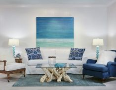 If you want a coastal style for your space, you will find plenty of inspiration here. To add pattern to a beach house living room, throw pillows are the perfect ways. Also add an element of shimmer by incorporating mirrored pieces such as the console and mercury glass vases. Also keep your space simple and put a greater focus on varied textures so your eye does not bounce all over the place. Continue Reading →