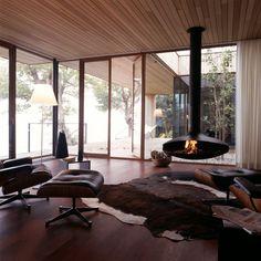 Floor to ceiling windows & mod fireplace rock! House Lindau by k_m architektur