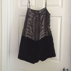 Black and grey snake skin romper Snake skin top and black shorts bottom romper. Adjustable straps. Romper zips up the side and has a secure bottom to keep in place. Shorts have pockets. Shell and lining are both 100% polyester. Offers welcome using offer feature please. Pet free and smoke free home :) H&M Dresses