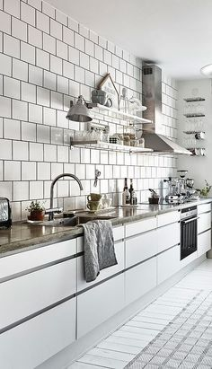 Look at this happy and cozy white kitchen. The concrete surfaces combine very well with the clean white tiles and I like the small breakfast table on the opposing wall as well. You can see that this kitchen belongs to … Continue reading → Kitchen Renovation, Modern Kitchen Tables, House Interior, Kitchen Decor, Kitchen Remodel, White Kitchen, Kitchen Design Decor, Kitchen Interior, Smart Kitchen