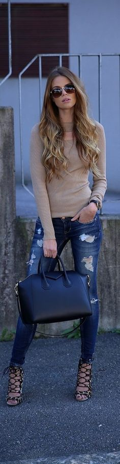 Josefin Ekström wears funky strapped heels with distressed jeans and a simple beige top.