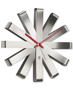 Keep track of the time in style! Umbra's Ribbon Wall Clock features a unique design with red hands and a stainless steel finish for a completely modern look. Designed by Michelle Ivankovic for Umbra.