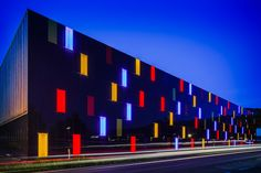 Colored BIPV facade with LED glass elements of OMICRON in Austria. Made by SUNOVATION