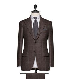 This cloth is a Brown-Black Mouliné with a Medium Grey Windowpane. Cloth Weight: 300g Composition: 100% Wool.