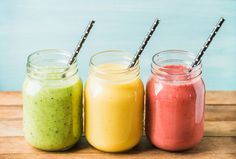 Three jars of fresh fruit smoothies with various colors and tastes. Three jars with cocktail straws with fresh fruit smoothies of various colors and tastes. Fruit Smoothies, Low Carb Smoothies, Easy Smoothies, Weight Loss Smoothies, Detox Smoothies, Breakfast Smoothies, Cucumber Smoothie, Detox Juices, Smoothie Cleanse