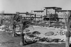 The Flamingo Hotel pool area in Las Vegas, as it looked in the immediate post-Bugsy Siegel days Via the collection of Burton Frasher Sr. at the Pomona Public Library Mafia, Flamingo Hotel, Las Vegas Photos, Hotel Pool, Sin City, Peek A Boos, Senior Photos, Nevada, Vintage Photos