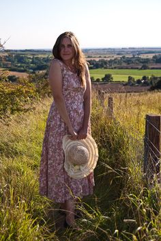 Jane Air at a beauty spot in Lincolnshire with a view of the wolds in the backdrop. This dress has SOLD. Laura Ashley, Straw Bag, Vintage Dresses, Backdrops, Floral, How To Wear, Beauty, Fashion, Vintage Gowns