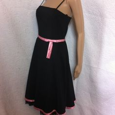 Retro looking black dress . Adorable black dress - pink bow tie at waist - spaghetti  straps  - lined top & skirt with wide lace on bottom. No rips tears or stains. Bust 34 waist 28 length 41. Dresses