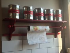 old shelf in the new colors red and cans of milk for the baby to store spices