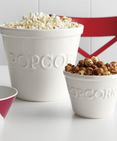"""Molded with the word """"popcorn"""", this white earthenware popcorn bowl is the perfect addition to your next movie night. Made of high-fired glazed earthenware, this bowl has a fun embossing with popcorn spelled out. Matching individual popcorn bowlsare also available."""