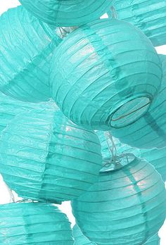 turquoise shades.....love these for a beach party or wedding. Inspiration of aqua tints from the ocean or sea...love Chinese lanterns...gives you a high decorative quotient for small amount of money...creates amazing atmosphere!!!