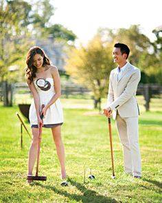 Guests play croquet on the sprawling lawn.....Love the idea of people playing games at a reception appose to just dancing.