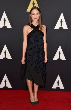 Keira Knightley walked the red carpet in a black Nina Ricci dress.