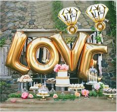Engagement party decor idea - gold LOVE balloons and diamond balloons with dessert display {Courtesy of Sharing Party Ideas}