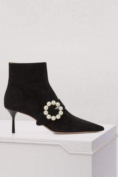 20b89e8be1bb Buy Miu Miu Buckle ankle boots online on 24 Sèvres. Designer Shoes